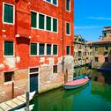 Stock Photo of venice cityscape, water canal, boats and traditional buildings. italy
