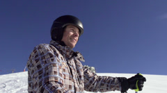 Professional Skier Enjoying The Sun On The Snowy Slope Stock Footage