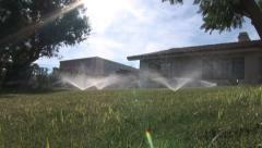 Southern California Home Watering Lawn 4 in series Stock Footage