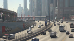 Busy traffic car highway financial center lane track Dubai city urban life tower Stock Footage