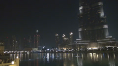 Burj Khalifa lake water illuminated building night darkness Dubai fun landmark  Stock Footage