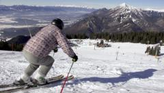 Slow Motion Of Back-Country Skier Skiing Down The Slope - stock footage