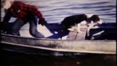 834 - fishermen come to shore, dog gets in boat - vintage film home movie - stock footage