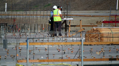 Construction workers read documentation development site Stock Footage