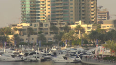 Closeup bar terrace port line dock ship boat Dubai Marina tourism sunny day bay Stock Footage