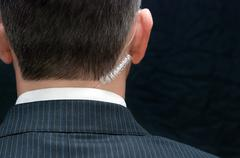 secret service agent, behind - stock photo