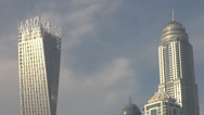 Stock Video Footage of Dubai Marina district area skyscraper tower building blue sky residential block