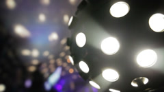 Disco Light Ball Spinning and Blurry DJ in the Background - stock footage