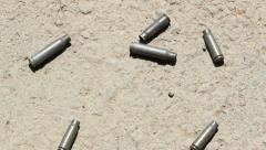 Shell casings. Handheld shot. 720p stabilized footage. - stock footage
