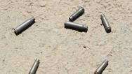 Stock Video Footage of Shell casings. Handheld shot. 720p stabilized footage.