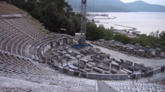 Ancient Amphitheater in Greek island, tourist taking pictures, harbor Stock Footage