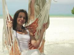 Happy couple relaxing on hammock on beautiful exotic beach NTSC - stock footage