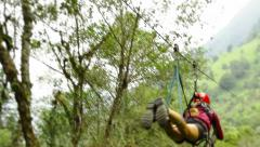Young women while zip line in the Ecuadorian rainforest, yelling and screaming, Stock Footage