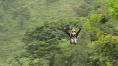 Camera tracks a young women on the zip line over 300m of cable Stock Footage