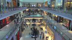 Interior shopping mall Dubai shop complex business people customer modern luxury Stock Footage