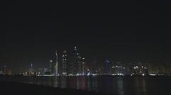 Panoramic panorama Dubai Marina night illuminated skyscraper seafront building  Stock Footage