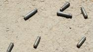 Stock Video Footage of Shell casings. Handheld shot.