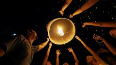 Stock Video Footage of Tourists Releasing Floating Lantern at Loi Krathong Festival in Thailand