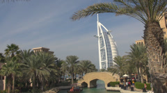 Burj Al Arab paradise palm tree resort Dubai blue sky landmark icon building day Stock Footage