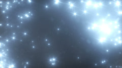 Blue Stars and Snow Falling from the Sky at Night Isolated on Black Background - stock footage