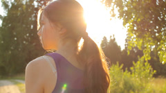 Girl walking in natural environment in the country Stock Footage