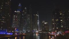 Dubai Marina bay promenade night residential tower building light famous modern - stock footage