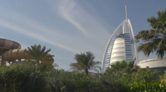 Burj Al Arab design icon landmark palm tree blue sky Dubai attraction resort  Stock Footage