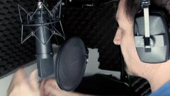 Voiceover artist recording in vocal booth Stock Footage