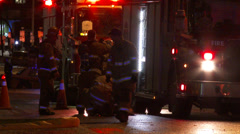Firemen putting away equipment Stock Footage