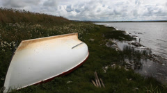 A boat lies by the side of a loch in Orkney, Scotland Stock Footage