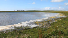 By the side of a loch in Orkney, Scotland Stock Footage