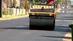 Heavy tandem Vibration roller compactor at asphalt pavement  Stock Footage