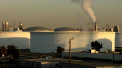 Round Petrochemical storage tank with smokestack Stock Footage