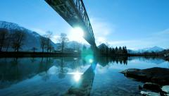 Lake sea river pond. mirror water reflection. silhouette of bridge Stock Footage