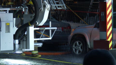 Water drops coming from firetruck basket Stock Footage