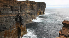 Waves crash against sea cliffs in Orkney, Scotland Stock Footage