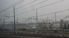 Train window view, arriving at bleak Milan train station (long tracking shot) Stock Footage