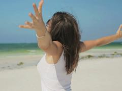 Excited, happy woman enjoying beautiful beach, freedom concept NTSC Stock Footage