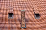 Stock Photo of architecture detail chimney and garret red tiles roof