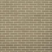 closeup of brownish green brick wall as background or texture - stock photo