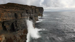 Large waves crash against rock cliffs in Orkney, Scotland Stock Footage