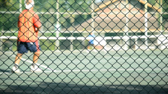 Playing Tennis in morning Stock Footage