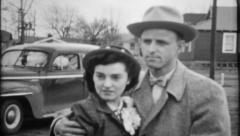 844 - classic well dressed couple - vintage film home movie - stock footage