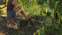 Pretty girl escapes from city and enjoying the silence of the country, steadicam Stock Footage