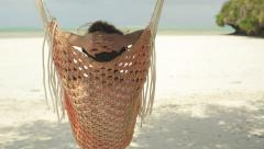 Woman relaxing on hammock on amazing exotic beach HD - stock footage