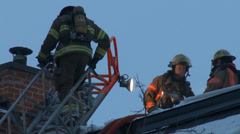 Firefighters climbing up and down a ladder Stock Footage