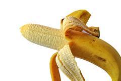 Peeled banana on white background Stock Photos