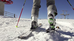 Slow Motion Of Attaching Ski Boots To Skis Stock Footage