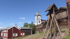 ROROS, NORWAY: Church tower pan belfry + blackened wooden house Stock Footage