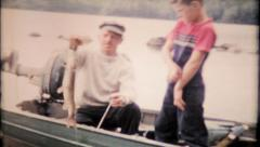 839 - father and son fishing together at local lake - vintage film home movie Stock Footage